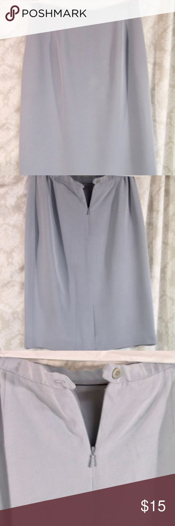 Jones New York Pale Blue pencil skirt 6 Jones New York Pale Blue pencil skirt 6  Vintage purchased 1993  Jones New York  Size:  6 The skirt has an unusual color a very PALE blue with a near grey tint (SEE PHOTOS) Back zipper and button  A slit at the back hem has not been opened yet 100% Silk Dry Clean Only  Pre Owned, no defects, tears, stains.. **Newly dry cleaned, see label.  Please let me know if you have any questions…. HAPPY to receive reasonable offers and encourage bundles!! Thank…