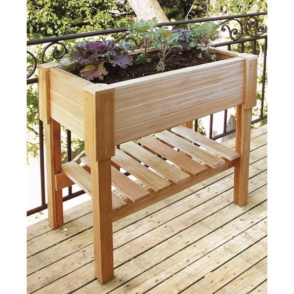 great wooden planter boxes idesa love the shelf for pots soil or whatever storage you need would make a great raised herb bed for my outdoor canning