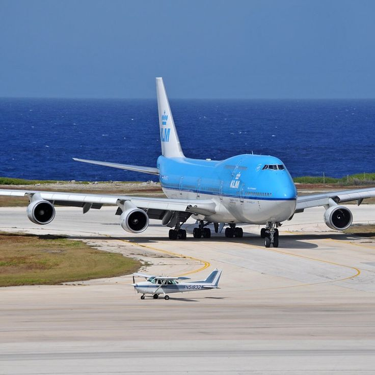 Love the contrast of one of the world's largest planes next to one of its smallest planes.