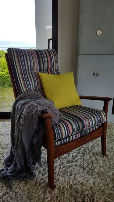 Updated Mid Century arm chair. Sanded, waxed and re-upholstered in TV stripe fabric. It fits with so many different decor styles.