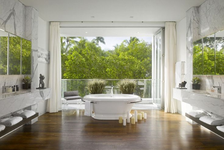 The master en-suite has a large roll top bath with a balcony and views over the garden bel...
