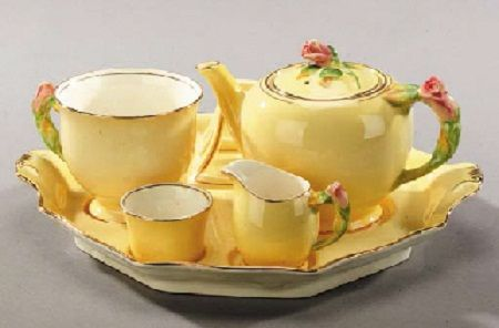 "Antique Royal Winton Grimwades yellow ""Rosebud"" breakfast set. Includes teapot, cup, toast rack, sugar, creamer and tray."