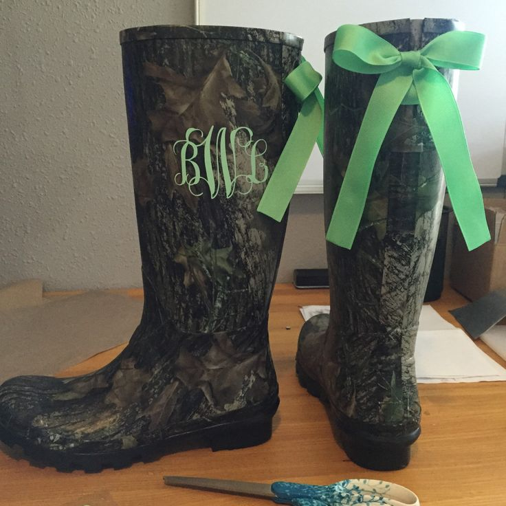 Working on a pair of camo custom boots. Tall black camo rain boots with bows and monogram in mint. Order yours today!