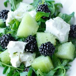 Refreshing Summer Salad   cut up melon w/ 1 cup blackberries or blueberries, arugula, some feta cheese and 1 tsp extra virgin olive oil  Honey ginger sauce:  2 tablespoons honey, 2 teaspoons grated ginger,  pinch of salt and freshly ground black pepper, 1 teaspoon lime juice or lemon. This will serve 2.