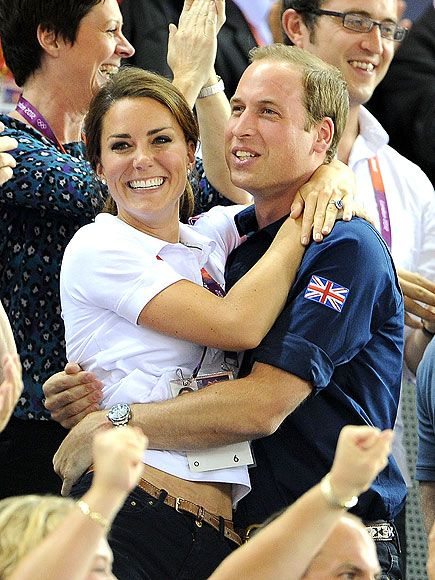 William and Kate hugging and cheering on the Great Britain cycling team on Day 6 of the 2012 Olympics.