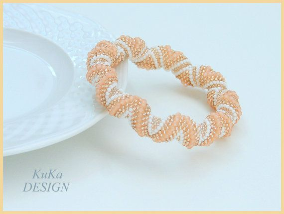 https://www.etsy.com/listing/243788652/zig-zag-cellini-spiral-beaded-bracelet?ref=shop_home_active_89