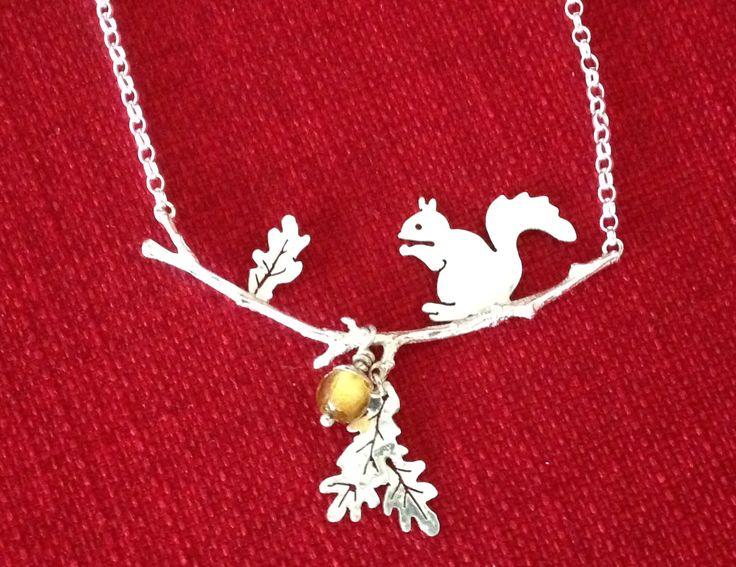 Silver squirrel necklace made from silver metal clay, silver sheet and glass foiled bead for acorn.