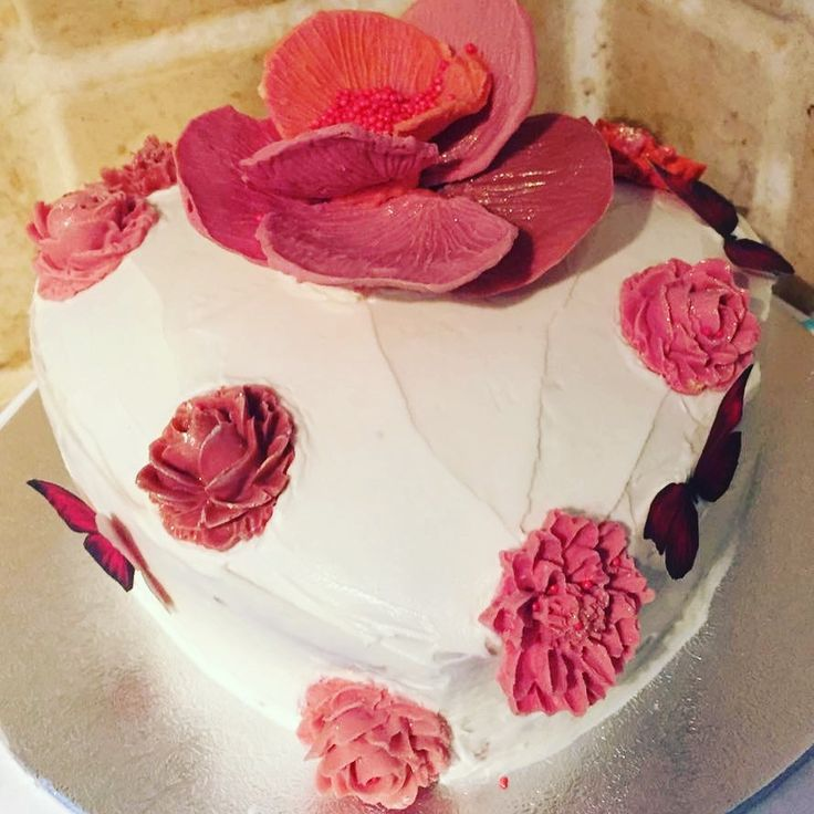 This cake was made for a birthday, it is a vanilla sponge with caramel buttercream icing and chocolate flowers.