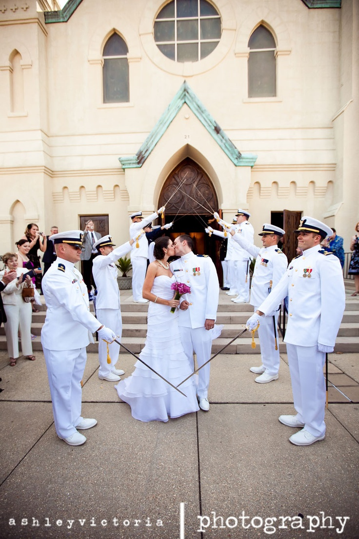 Navy Military Wedding Sabre Arch Bride & Groom Kiss   View more from this wedding: http://www.ashleyvictoriaphotographyblog.com/2011/07/15/molly-greg-are-married-st-michael-catholic-church-part-1/