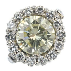 LOT:169   An 18ct gold 'Fancy Light Yellow' diamond and diamond cluster ring.