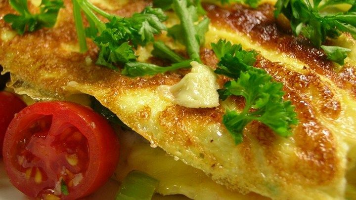 Great directions to make the most perfect, fluffy and foldable omelet. Stuffed with gently sauteed vegetables and lots of cheese. Yummy indeed.
