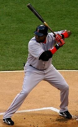 "David Américo Ortiz Arias (born 11/18/75), a/k/a ""Big Papi"", is a Dominican American professional baseball player who plays for the Boston Red Sox. Ortiz is a designated hitter (DH) who occasionally plays first base. He previously played for the Minnesota Twins from 1997–2002. Ortiz is a ten-time All-Star, a three-time World Series champion, and holder of the Red Sox single-season record for home runs with 54, set during the '06 season."