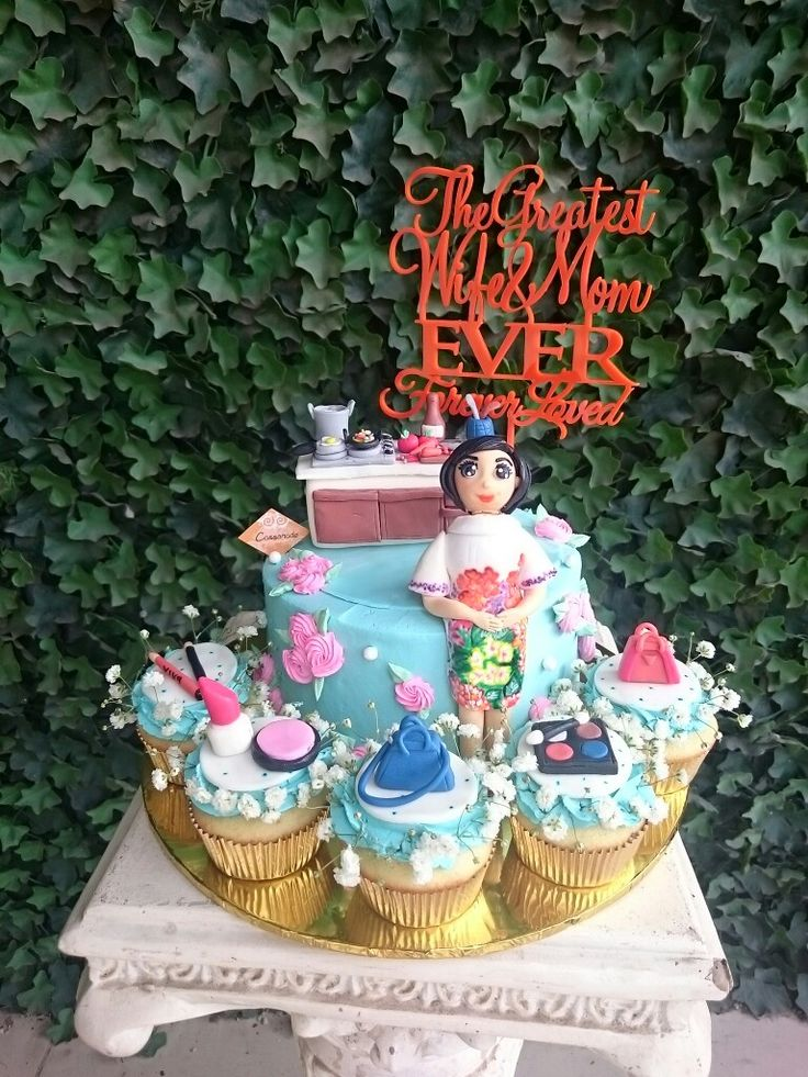 A one tier of Banana Chocolate Buttercream Cake, surrounded with Strawberry Cupcakes. With A duplicate of Mom's Fondant doll and her favorite things (Make Up, Bags, Cooking stuffs)