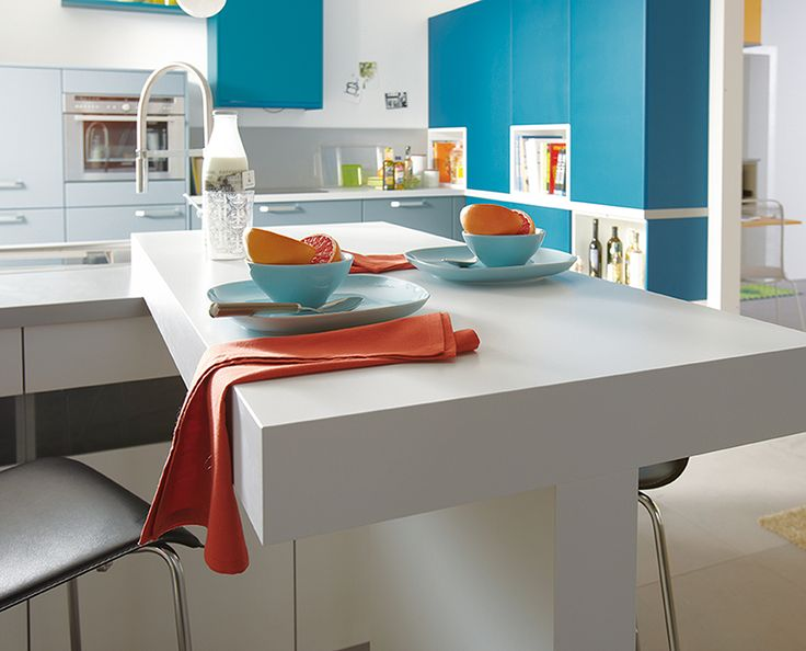 Schuller kitchens white table and blue cabinets