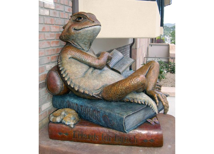 """Sculpture by Heather Johnson Beary    ------ Commissioned by the Friends of the Library, the """"Library Lizard"""" is a welcoming presence at the north entrance of the Downtown Prescott Public Library. In the spirit of the library's educational mission, you can learn about the short-horned lizard by reading the book in the lizard's hand."""
