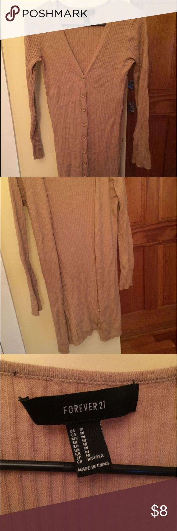 F21 CAMEL CARDIGAN Ribbed  camel long sleeve cardigan// also can be worn as a dress. Small stain near one of the buttons, pics as requested! Wrinkly because it's been sitting in my draw for so long 😂 Forever 21 Sweaters Cardigans