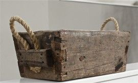 Interior design: wooden basket, rustic, rope handles.