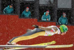Lahti, Finland, Judges watch Hannu Manninen, of Finland, at the FIS Nordic Ski World Championships