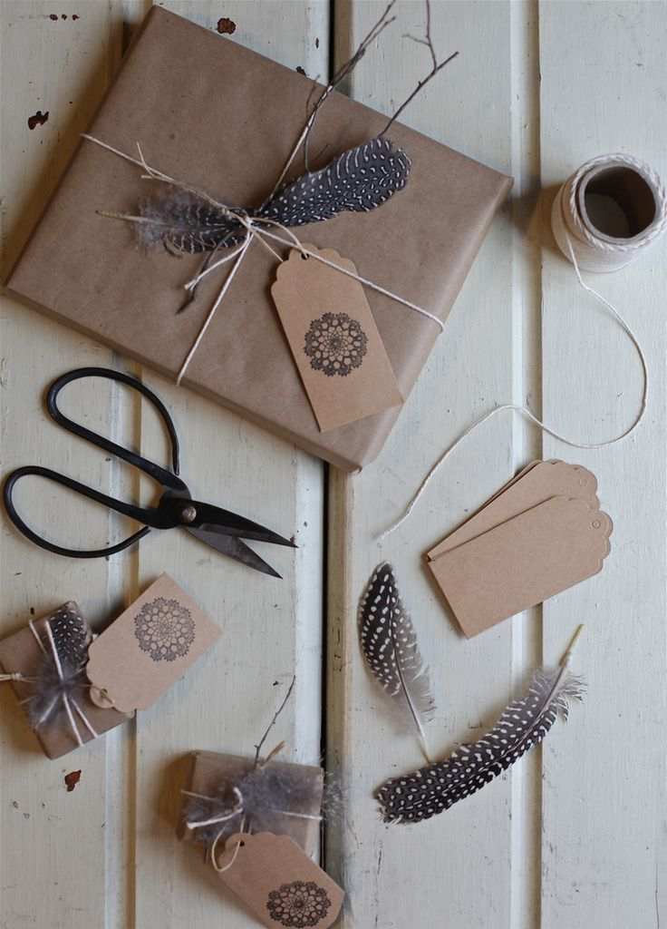 gifts topped with feathers and twigs