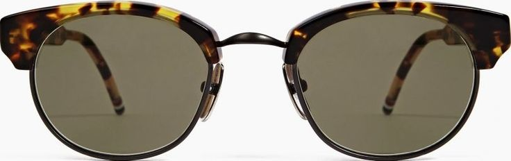 Thom Browne TB-702 Tortoiseshell Sunglasses The Thom Browne Men™s TB-702 Sunglasses, seen here in tortoiseshell. - - The TB-702 sunglasses from Thom Browne are hand-made by skilled craftsmen in Japan, with no detail overlooked in their producti http://www.comparestoreprices.co.uk/january-2017-6/thom-browne-tb-702-tortoiseshell-sunglasses.asp