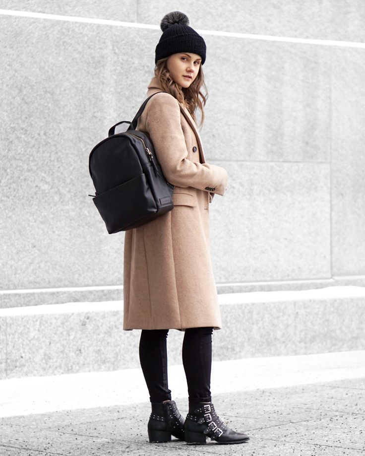 A Little Detail - Black Bobble Hat // Camel Coat // Black Leather Backpack // Studded Ankle Boots // #outfit #winterfashion #backpack #streetstyle #womensfashion #outfit #camelcoat #bobblehat #beanie