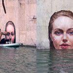 As exímias pinturas hiperrealistas do surfista Hula sobre uma prancha de stand up paddle
