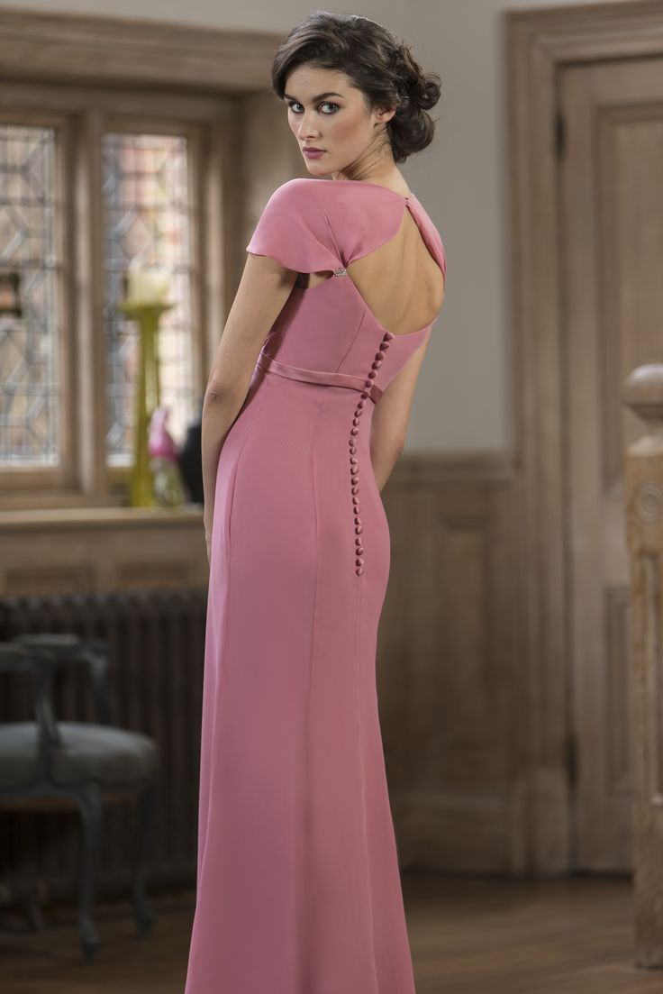 True Bridesmaid - M577 Chiffon slim a-line bridesmaid dress with fluted cap sleeve, sweetheart neckline and satin sash below bustline with flattering pleated skirt. Zip up back with keyhole detail and button trim. To view this dress please call 01273 736622 or visit http://www.oceanbride.co.uk/appointments. Our Bridesmaids dresses are available in over 90 beautiful colours!