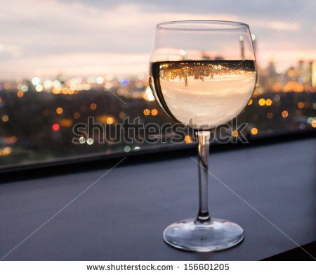 Glass of wine with city view - stock photo