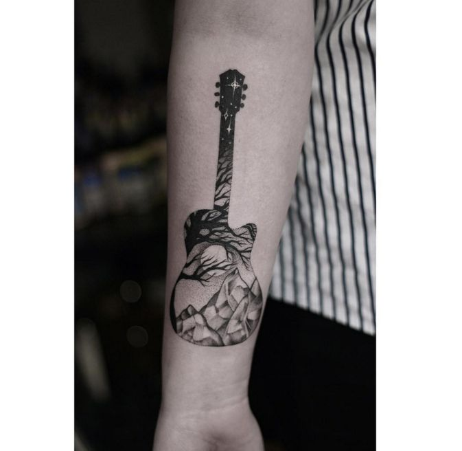 One of the most poetic guitar tattoos out there! By John Brass.