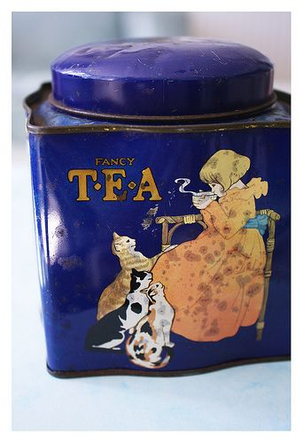 Vintage tea tin. Judging by the cats, the young lady takes her tea with cream.