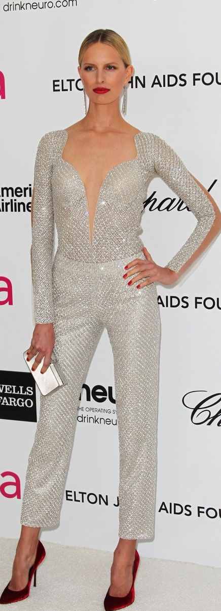 Karolina Kurkova looked amazing in this glittering, silver jumpsuit and red heels.