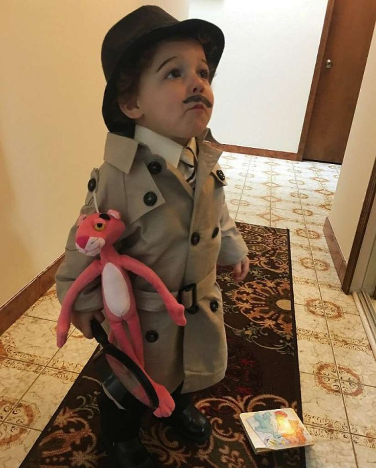 """INSPECTOR CLOUSEAU: Stacey's second entry: """"Our 19-month-old Wes actually earned the nickname 'Inspector Clouseau' due to his bumbling and clumsy (well, as toddlers often are) nature, so what could be more fitting than to dress him as the 'Pink Panther' star? He was patient for the mustache and eyebrow application, so naturally he was disinclined to post for a good photo."""""""