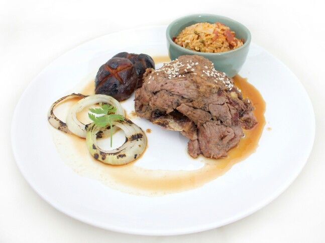 Korean La Galby; Authentic korean Short Ribs served with grilled mushroom, onion and kimchi fried rice.