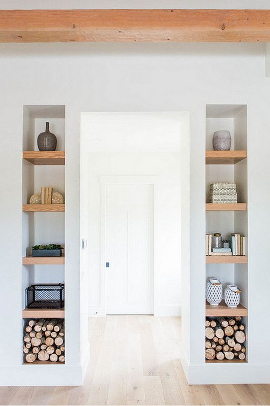 This arrangement utilizes clever use of the sliver of wall space that usually frames a doorway.