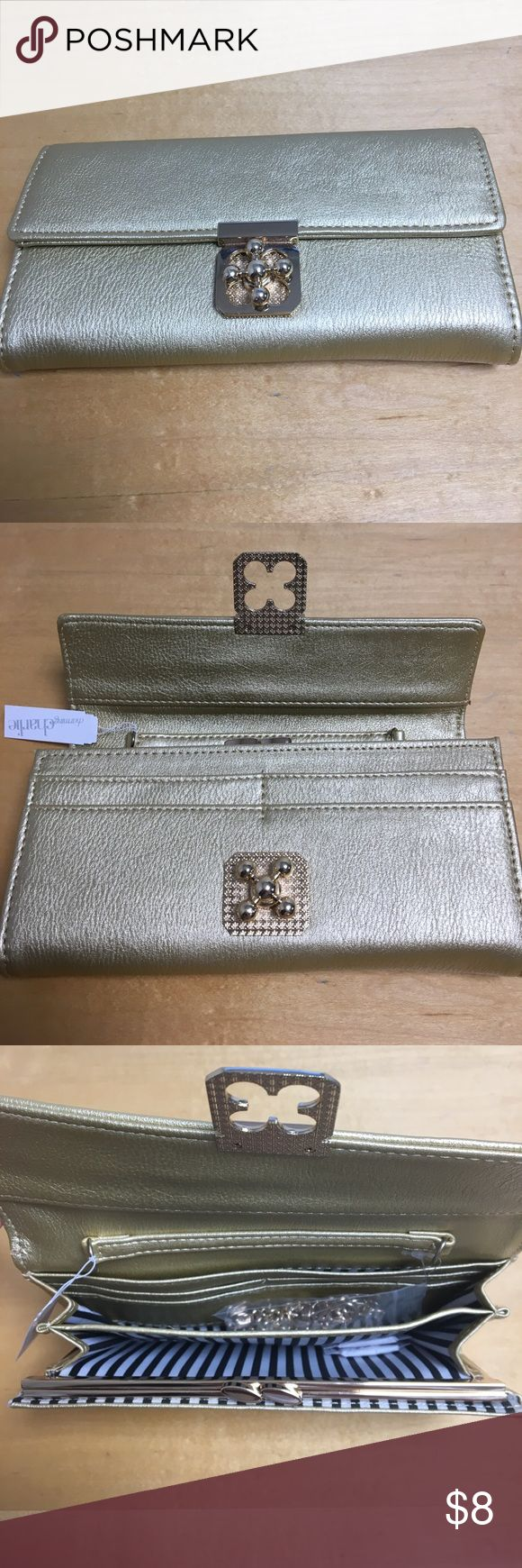 NWT Charming Charlie Gold Wallet with Chain NWT Charming Charlie gold wallet with drop down chain. Neat front clasp. Never been used. Charming Charlie Bags Wallets