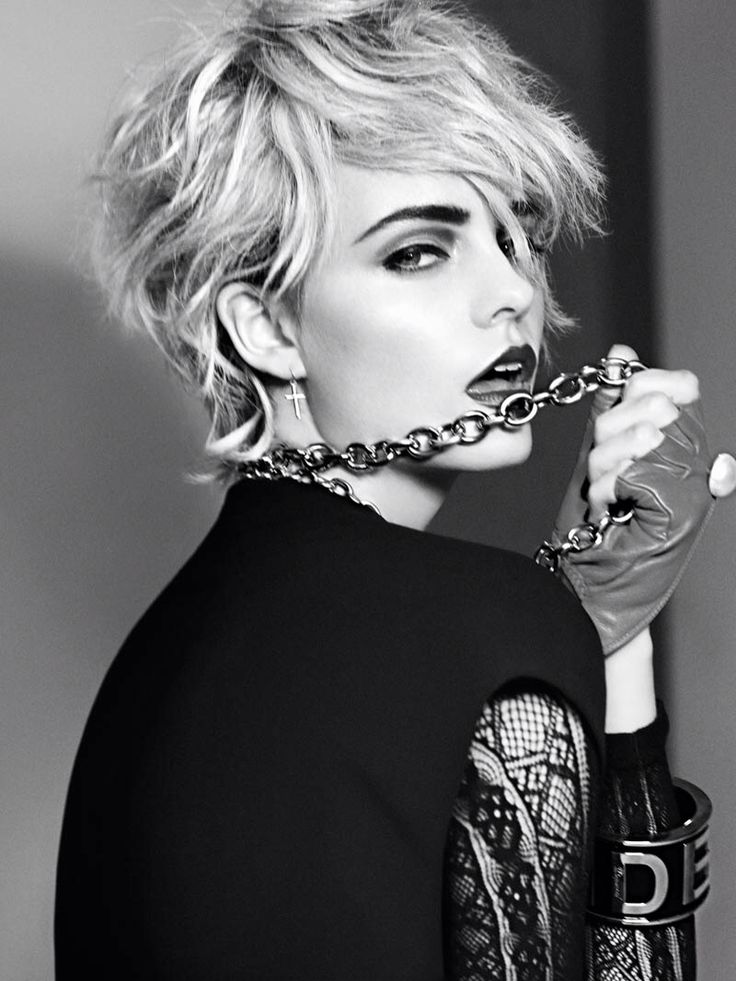 Madonna's hair. I am really in love with this pixie cut. I don't think I can/would be able to work out a pixie cut like Madonna in that picture. At least, I can admire pixie cuts.