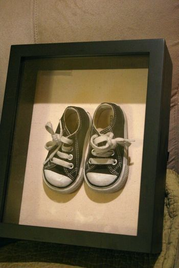 First shoes. Velcro sole of shoe to shadow box as a lovely keepsake.