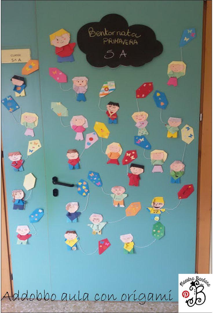 Ogni bambino ha preparato il proprio origami-bambino ed abbiamo addobbato la porta. Bello vero?