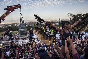 In the final photograph this week, students cheer as the Cecil Rhodes statue is removed from the University of Cape Town in South Africa. The statue of the British colonialist was withdrawn as a result of a month-long protest by students, who said the statue glorified a man 'who exploited black labour and stole land from indigenous people'