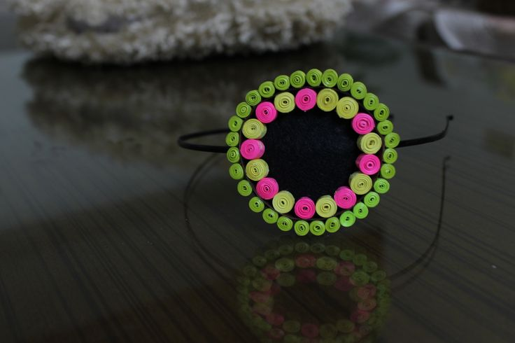 Neon colored quilled hair accessory.