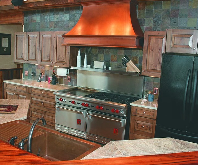 copper oven hood and sink