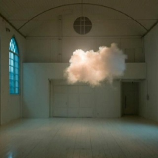 The artist uses a fog machine to create real clouds in indoor spaces. Absolutely breathtaking!