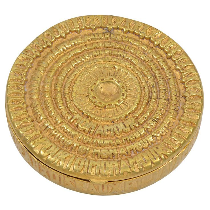 For you my love A bronze doré compact  Text from the Jacques Prévert poem Pour Toi Mon Amour wraps around the entirety of this compact.