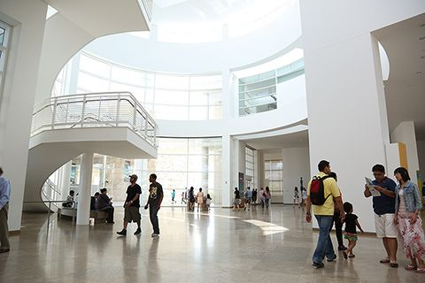 View of the Entrance Hall at the Getty Center, showing glass walls that allow sunshine to illuminate the interior.