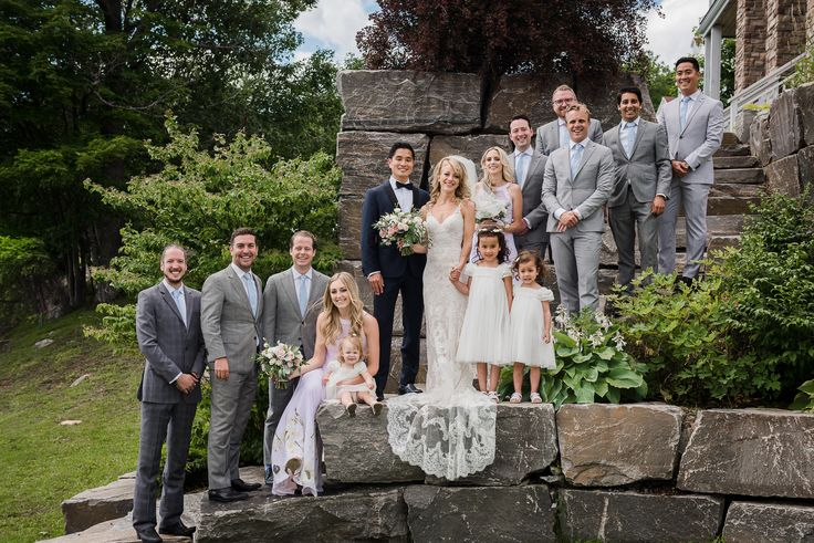 The whole wedding party on the steps of Windermere House here.