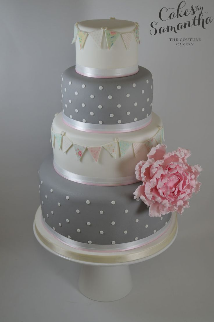 Victoria's Grey and tiny polka dots and fabric like bunting Wedding Cake.