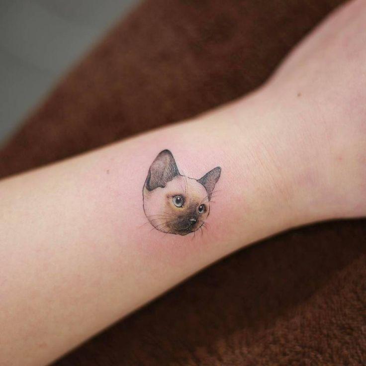 Siamese cat tattoo on the wrist. Tattoo artist: Doy