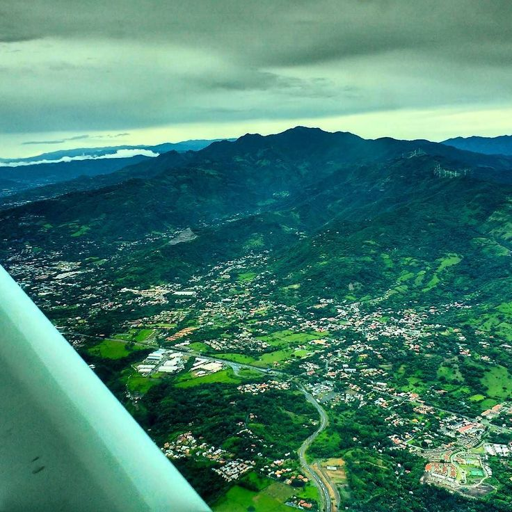 Overlooking the capital city of San Jose Costa Rica from a small 15-seater plane on my way back to the Quepos / Manuel Antonio airport. A quick 30-minute flight on Sansa Airlines. Beautiful scenery!