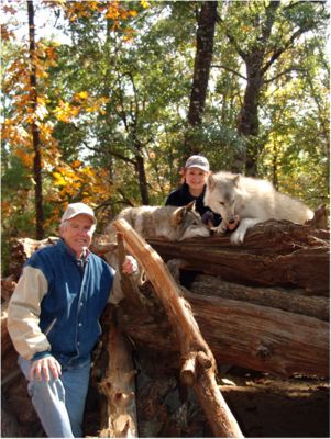 """Seacrest Wolf Preserve"" in Chipley, Florida: photo of owners Cynthia & Wayne (most giving people, honor to meet them): created a wolf preservation with DONATIONS & teach wolves r GOOD like dogs. Teachers Lou & Bertha & I took students on field trips: held wolves, HOWLED with wolves! Please support them: for a fee, visitors mingle with a pack & help keep them from being extinct. U'll love it! Go Facebook seacrestwolfpreserve.org - caption by Mari Parrilla"