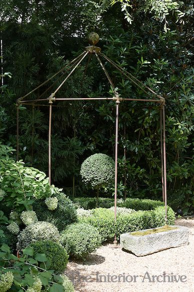 GARDEN STRUCTURES:  An iron gazebo from Anthropologie sits at the end of the gravel driveway.  Could I make this from copper plumbing pipe like my trellis?  Designed by Jill Brinson in Atlanta.